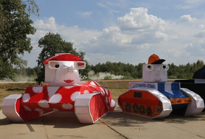 A tank drives past decorations on course of Tank Biathlon world championship in Alabino