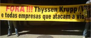 """""""Raus mit ThyssenKrupp und Vale und allen Firmen, die das Leben bedrohen!"""" Protestplakat in Rio de Janeiro, April 2010, Photo: Christian Russau CC BY 3.0"""