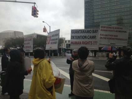 Demonstration across street from UN protesting against UN Human Rights report as unfairly targeting North Korea